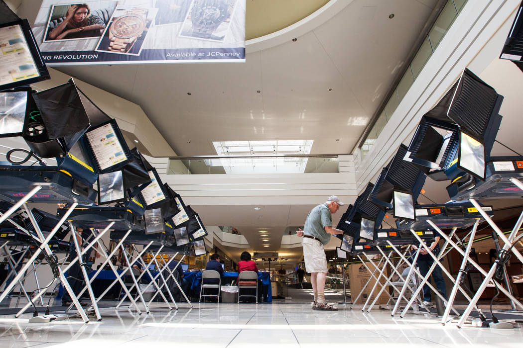 James Green of Las Vegas casts his ballot on the first day of early voting at the Meadows Mall in Las Vegas on Saturday, May 24, 2014. (Chase Stevens/Las Vegas Review-Journal)