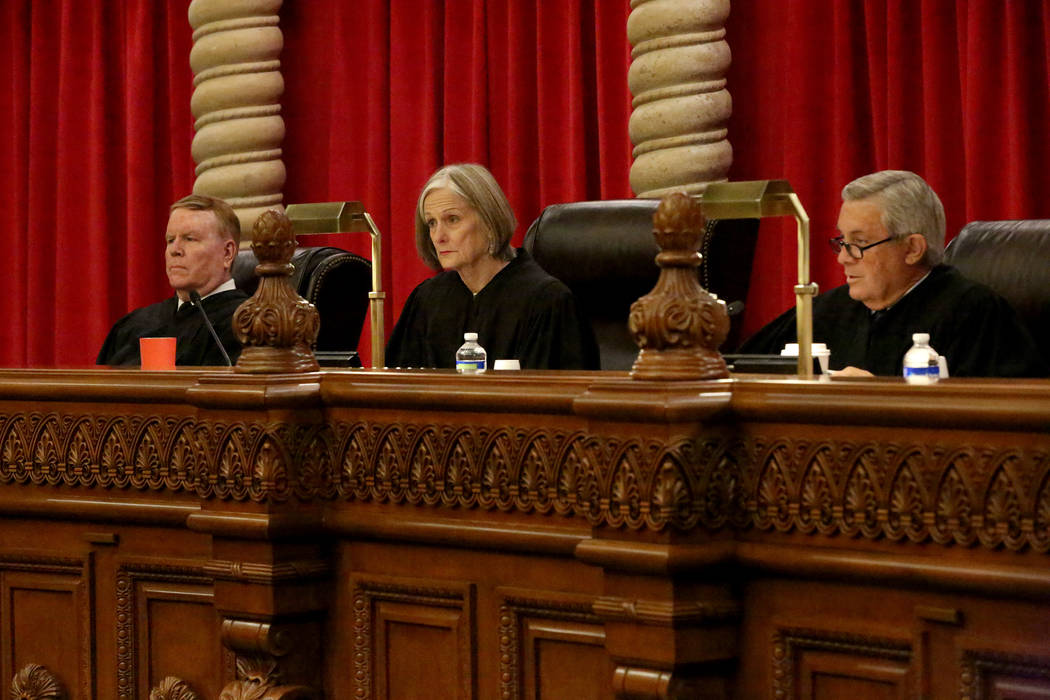 Nevada Supreme Court Justices Michael L. Douglas, left, Kristina Pickering and James W. Hardesty listen to arguments in the the Leonard vs. State death penalty case on Tuesday, April 4, 2017. Mich ...