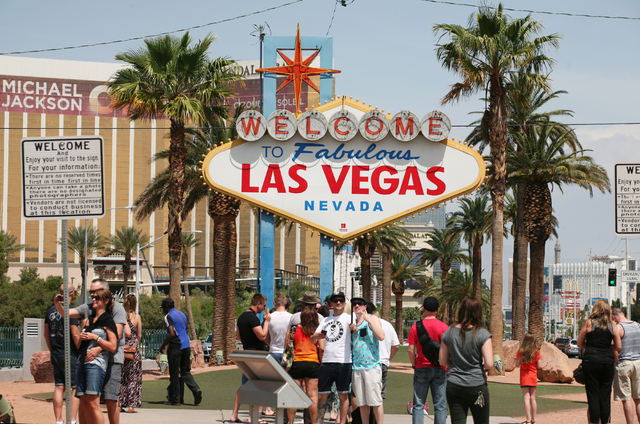 People visit the historic Welcome to Fabulous Las Vegas sign on the south end of the Strip on Thursday, April 23, 2015, in Las Vegas.  (Ronda Churchill/Las Vegas Review-Journal)