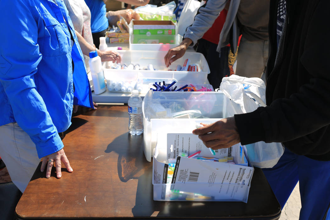 Those in need get toothpaste, razors and toothbrushes at The Giving Project, an event designed to help those in need, at 1401 Las Vegas Blvd. North on Saturday, April 8, 2017. (Brett Le Blanc/View ...
