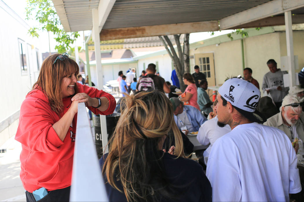 Ginger McLaughlin, left, talks with a table of eaters at The Giving Project, an event designed to help those in need, at 1401 Las Vegas Blvd. North on Saturday, April 8, 2017. (Brett Le Blanc/View ...