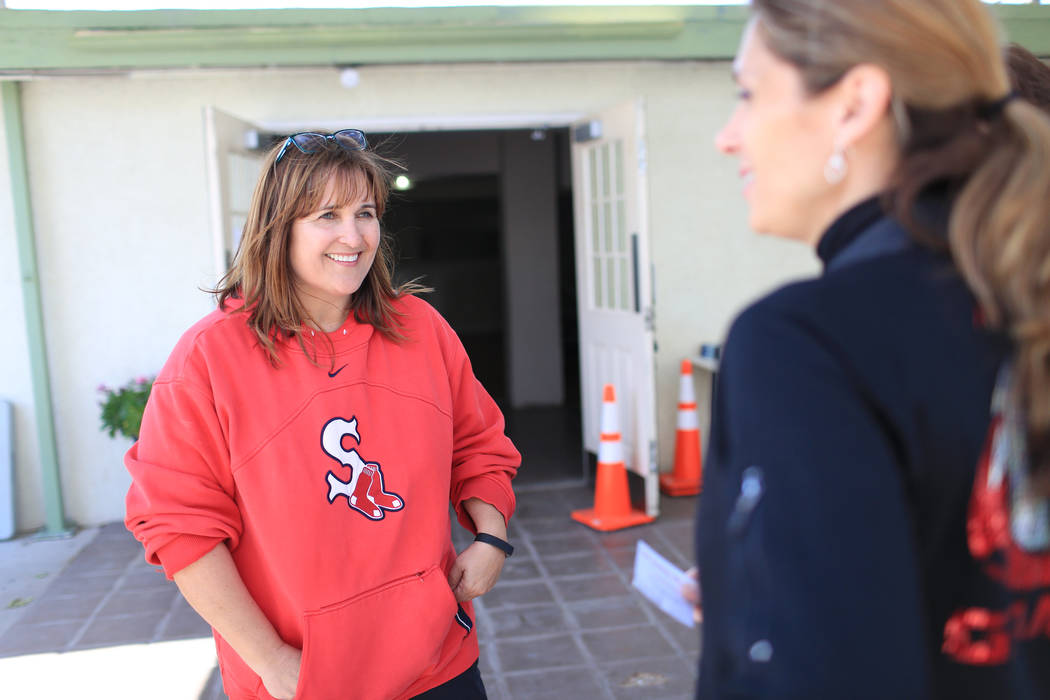 Ginger McLaughlin, left, talks with Tari Smethurst, a teacher at Sandi Miller Elementary, right, at The Giving Project, an event designed to help those in need, at 1401 Las Vegas Blvd. North on Sa ...