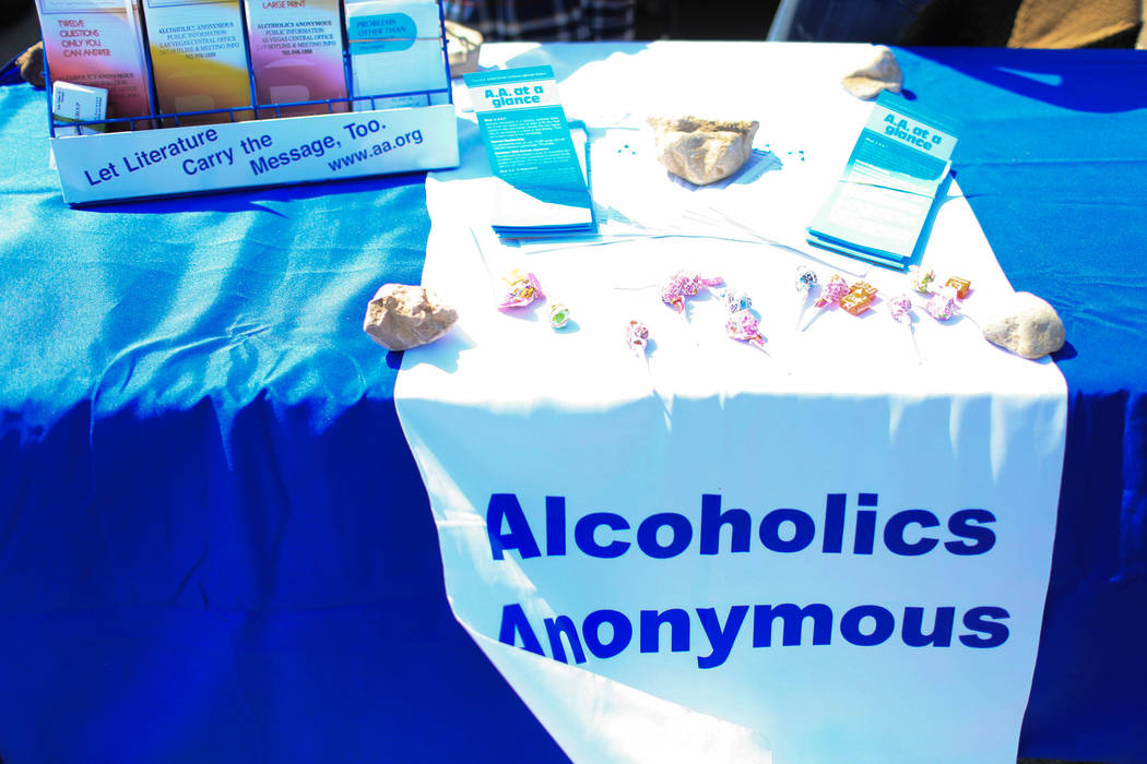 An Alcoholic Anonymous booth offers help at The Giving Project, an event designed to help those in need, at 1401 Las Vegas Blvd. North on Saturday, April 8, 2017. (Brett Le Blanc/View) @bleblancphoto