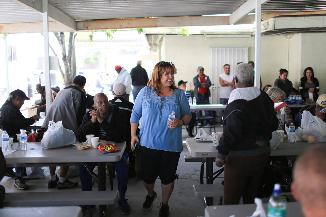 Ginger McLaughlin, center, talks with everyone she can in the dining area of The Giving Project, an event designed to help those in need, at 1401 Las Vegas Blvd. North on Saturday, April 8, 2017.  ...