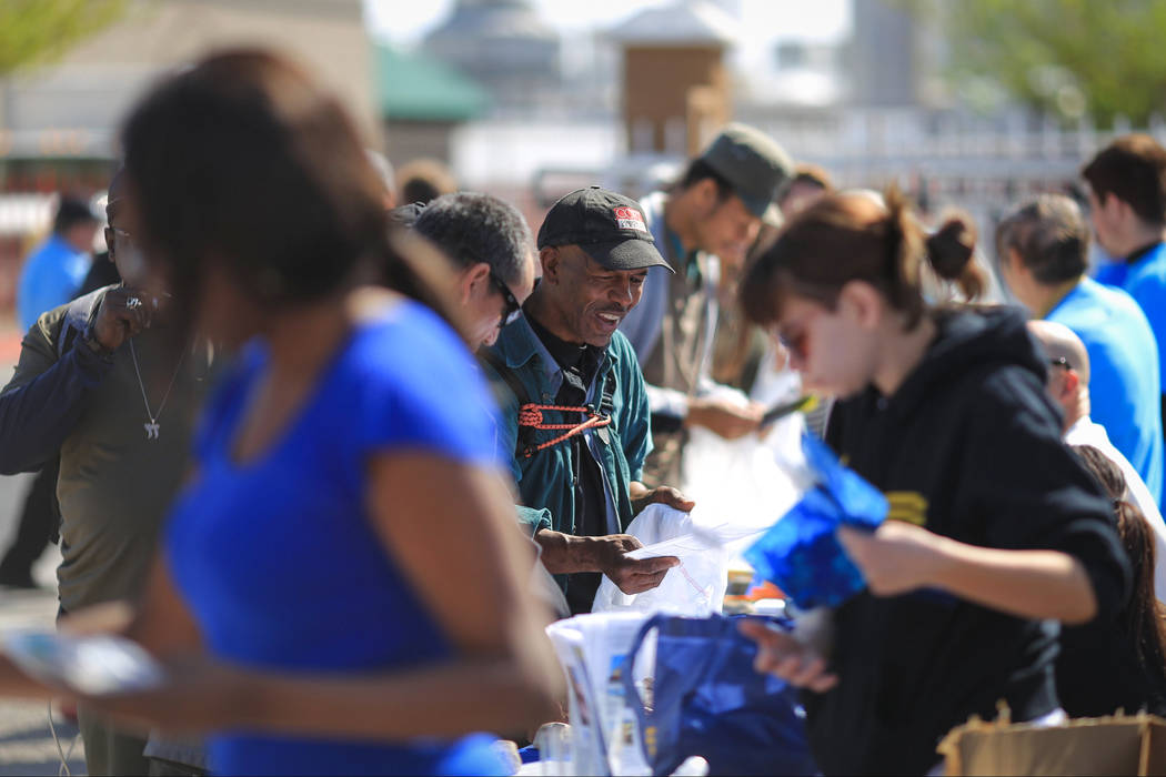 A man who declined to give his name cracks a smile while looking at offerings from volunteers at The Giving Project, an event designed to help those in need, at 1401 Las Vegas Blvd. North on Satur ...