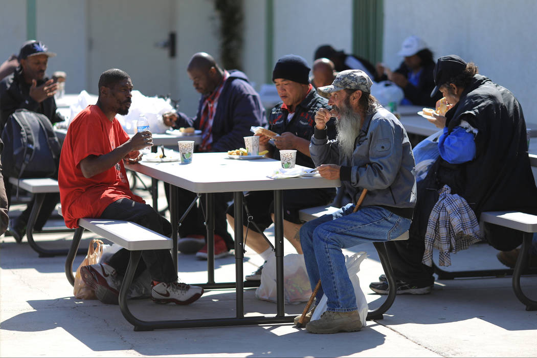 Diners enjoy free meals given out at The Giving Project, an event designed to help those in need, at 1401 Las Vegas Blvd. North on Saturday, April 8, 2017. (Brett Le Blanc/View) @bleblancphoto