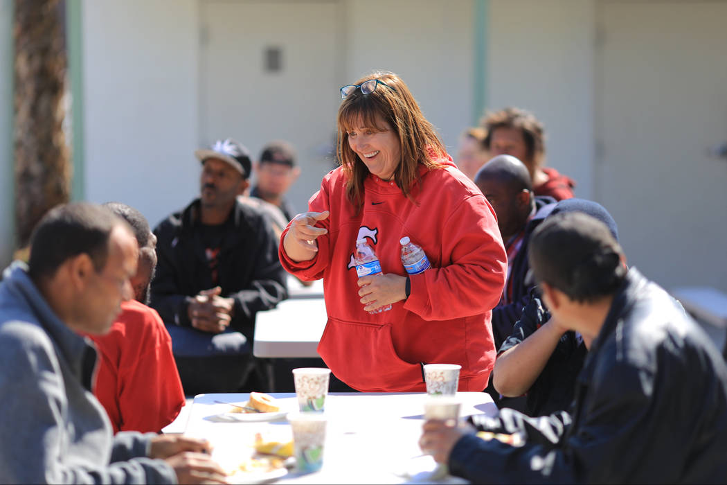 Ginger McLaughlin, center, talks with a table of diners at The Giving Project, an event designed to help those in need, at 1401 Las Vegas Blvd. North on Saturday, April 8, 2017. (Brett Le Blanc/Vi ...