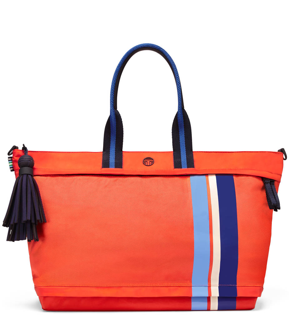 Tory Sport Soft Nylon Zip Satchel, made from durable and lightweight fabric, is shown in poppy red, has a sneaker compartment and yoga mat holder. Comes with signature removable tassel, woven doub ...