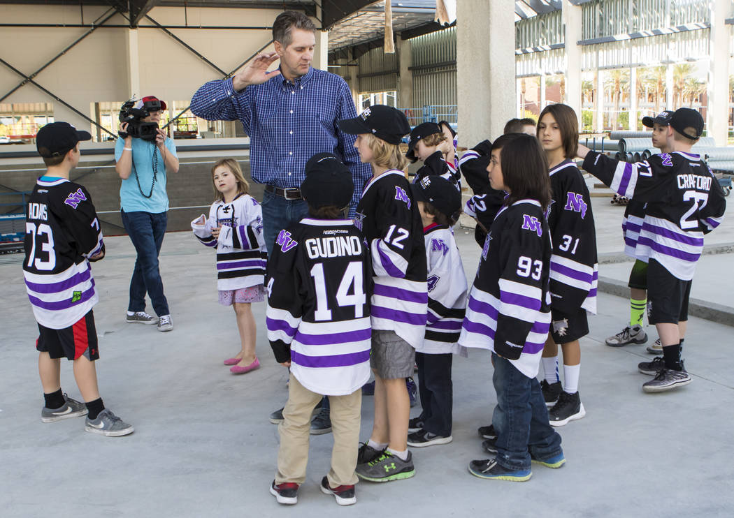 Senior Vice President for the Golden Knights Murray Craven gives participants with Nevada Storm youth hockey program a tour of the Golden Knights' practice facility construction site in Las Vegas  ...