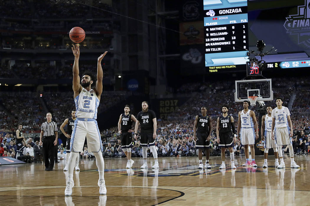 North Carolina's Joel Berry II (2) shoots a free throw during the second half in the finals of the Final Four NCAA college basketball tournament against North Carolina, Monday, April 3, 2017, in G ...