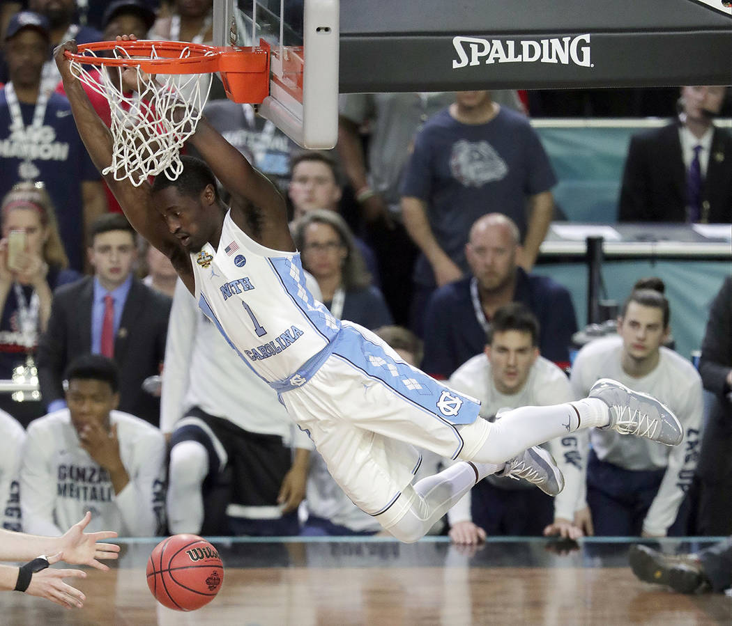 North Carolina's Theo Pinson (1) dunks during the first half in the finals of the Final Four NCAA college basketball tournament against Gonzaga, Monday, April 3, 2017, in Glendale, Ariz. (AP Photo ...