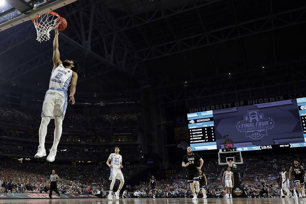 North Carolina's Joel Berry II (2) goes up for a lay up during the second half in the finals of the Final Four NCAA college basketball tournament against Gonzaga, Monday, April 3, 2017, in Glendal ...