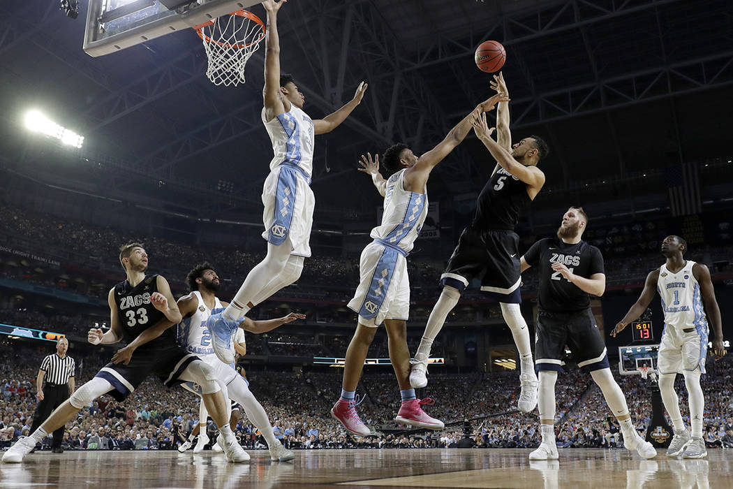 Gonzaga's Nigel Williams-Goss (5) takes a shot over North Carolina's Tony Bradley during the second half in the finals of the Final Four NCAA college basketball tournament, Monday, April 3, 2017,  ...