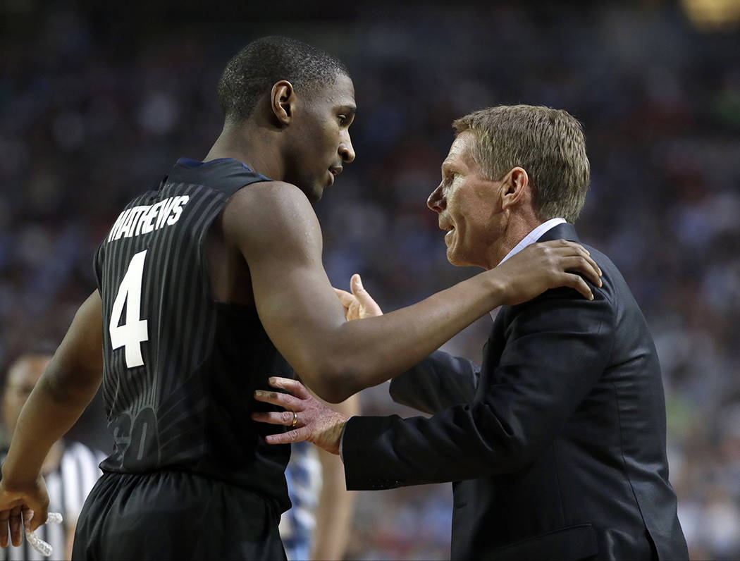 Gonzaga head coach Mark Few talks to Jordan Mathews (4) during the second half in the finals of the Final Four NCAA college basketball tournament against North Carolina, Monday, April 3, 2017, in  ...