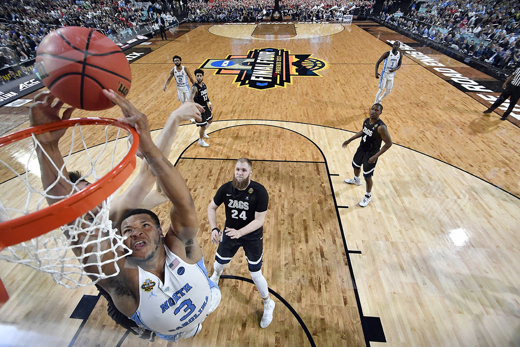 North Carolina's Kennedy Meeks (3) goes up for a shot against Gonzaga's Zach Collins during the second half in the finals of the Final Four NCAA college basketball tournament against Gonzaga, Mond ...