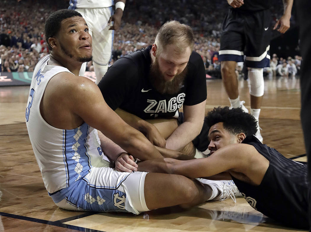 North Carolina's Kennedy Meeks (3), tg24n= and Silas Melson battle for a loose ball during the second half in the finals of the Final Four NCAA college basketball tournament, Monday, April 3, 2017 ...