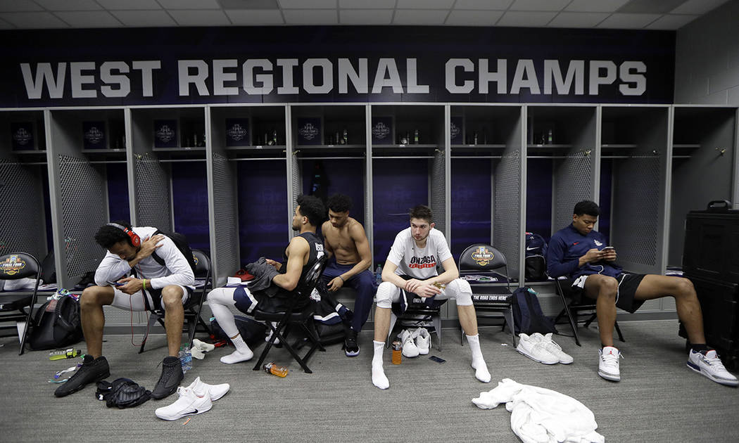 Gonzaga players sit in the locker room after the finals of the Final Four NCAA college basketball tournament against North Carolina, Monday, April 3, 2017, in Glendale, Ariz. North Carolina won 71 ...