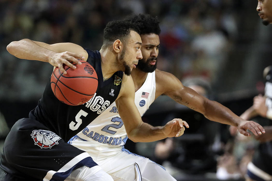 Gonzaga's Nigel Williams-Goss (5) drives against North Carolina's Joel Berry II (2) during the first half in the finals of the Final Four NCAA college basketball tournament, Monday, April 3, 2017, ...
