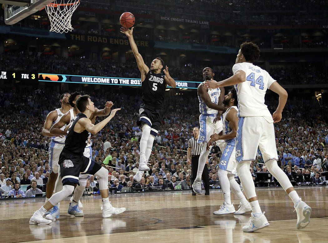 Gonzaga's Nigel Williams-Goss (5) goes up for a shot during the second half in the finals of the Final Four NCAA college basketball tournament against North Carolina, Monday, April 3, 2017, in Gle ...