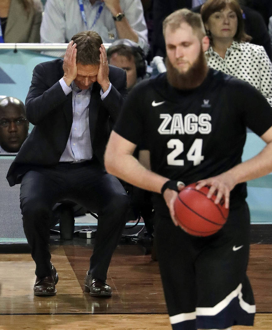 Gonzaga head coach Mark Few reacts as Przemek Karnowski (24) walks down on the court during the second half in the finals of the Final Four NCAA college basketball tournament, Monday, April 3, 201 ...