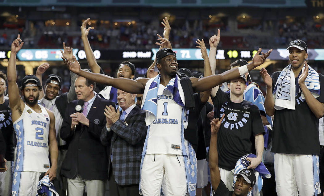 North Carolina's Theo Pinson (1) and the rest of the team celebrate after the finals of the Final Four NCAA college basketball tournament against Gonzaga, Monday, April 3, 2017, in Glendale, Ariz. ...