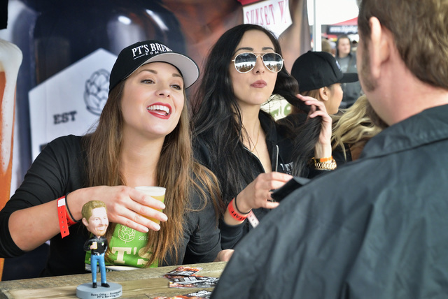 Heather Wood, left, and Ebru Yaltirakli serve beer at the PT's Brewing tent during the Great Vegas Festival of Beer in the 800 block of Fremont Street in Las Vegas on Saturday, April 9, 201 ...