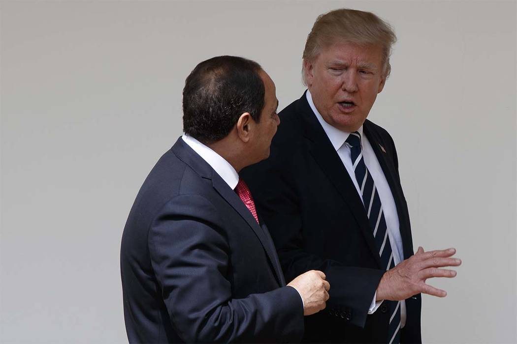 President Donald Trump walks with Egyptian President Abdel Fattah al-Sisi at the White House in Washington, Monday, April 3, 2017. (Ivan Vucci/AP)