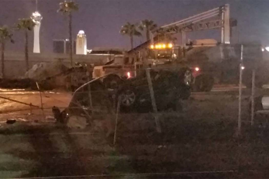 A car is on its roof after hitting a cement wall and flipping on North City Parkway between West Bonanza Road and West Ogden Avenue. (Mike Shoro/Las Vegas Review-Journal)