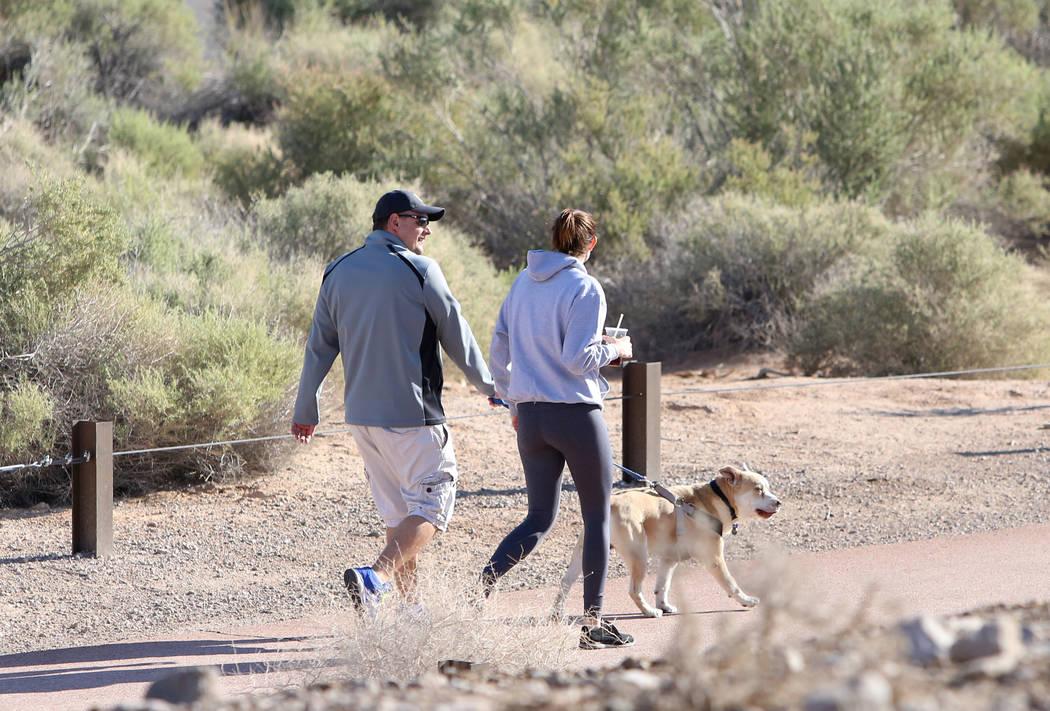Kyle Darin with his fiance, Maddie Perdisatt and their dog, Gordie, enjoy their walk at Sunset Park on Tuesday, April 4, 2017, in Las Vegas. (Bizuayehu Tesfaye/Las Vegas Review-Journal) @bizutesfaye