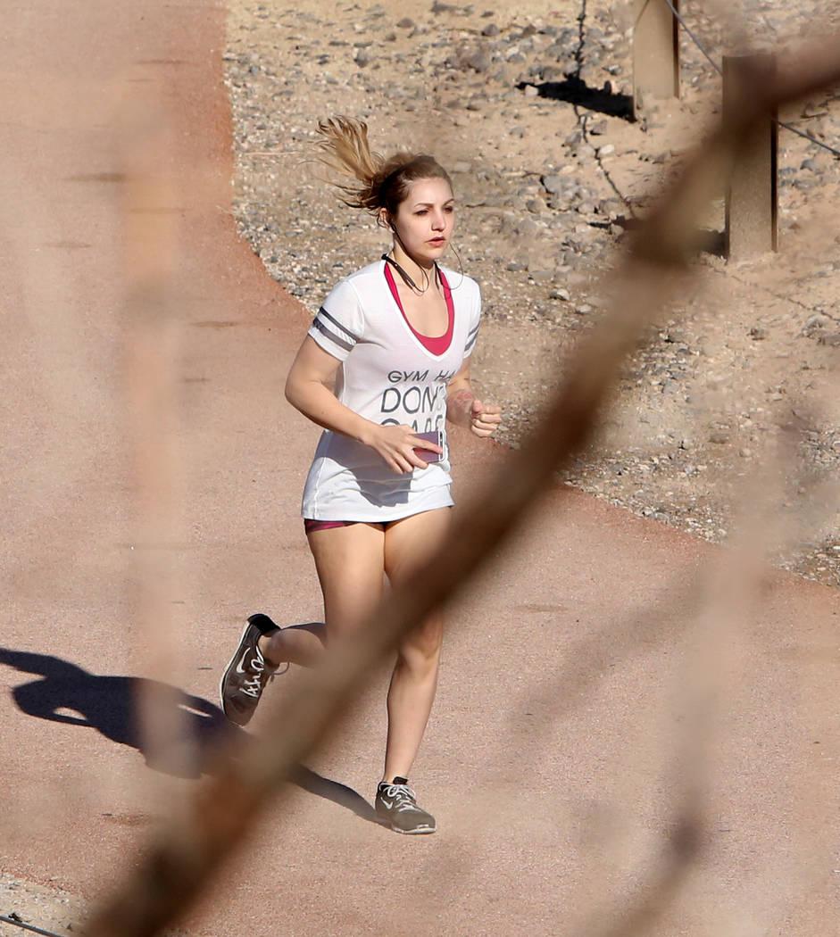 A woman goes for a run in Sunset Park on Tuesday, April 4, 2017, in Las Vegas. (Bizuayehu Tesfaye/Las Vegas Review-Journal) @bizutesfaye