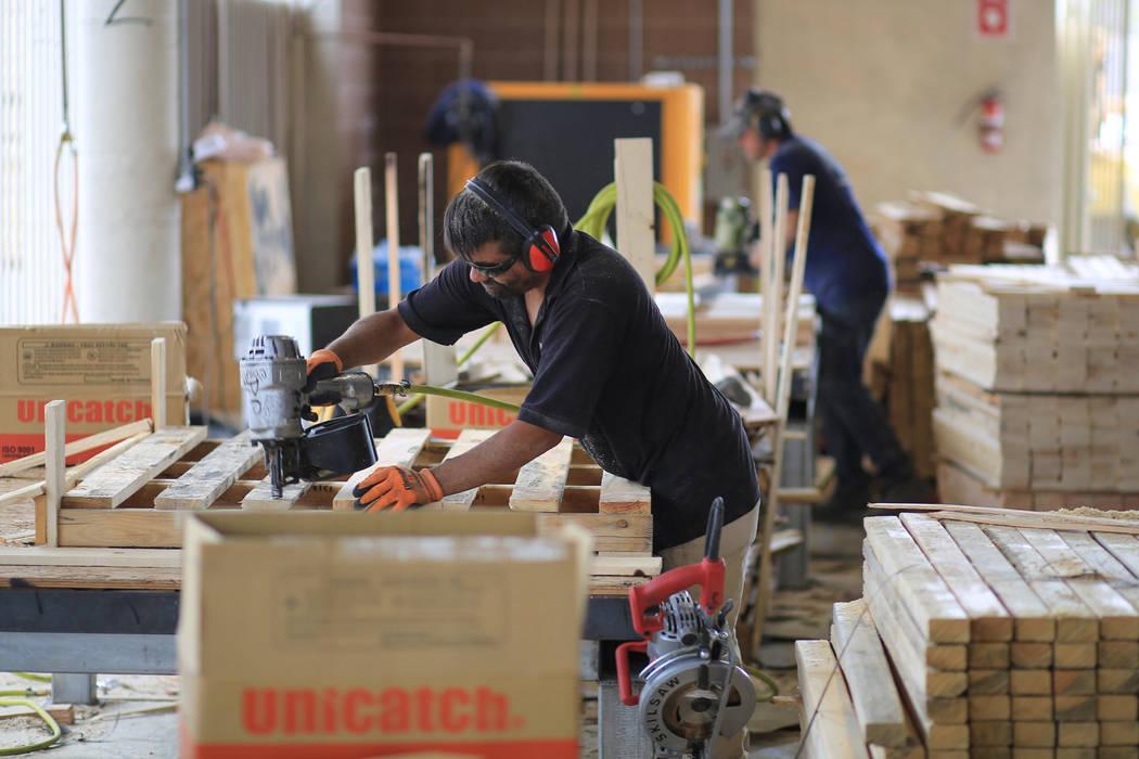 Nelson Mendoza builds a pallet at Power Pallets in North Las Vegas on Friday, April 7, 2017. (Brett Le Blanc Las Vegas Review-Journal) @bleblancphoto