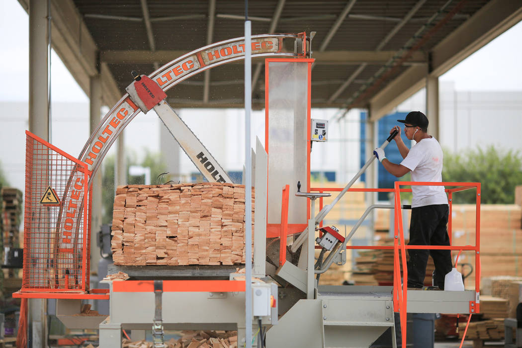 Tobias Morales cuts long planks of wood to size at Power Pallets in North Las Vegas on Friday, April 7, 2017. (Brett Le Blanc Las Vegas Review-Journal) @bleblancphoto
