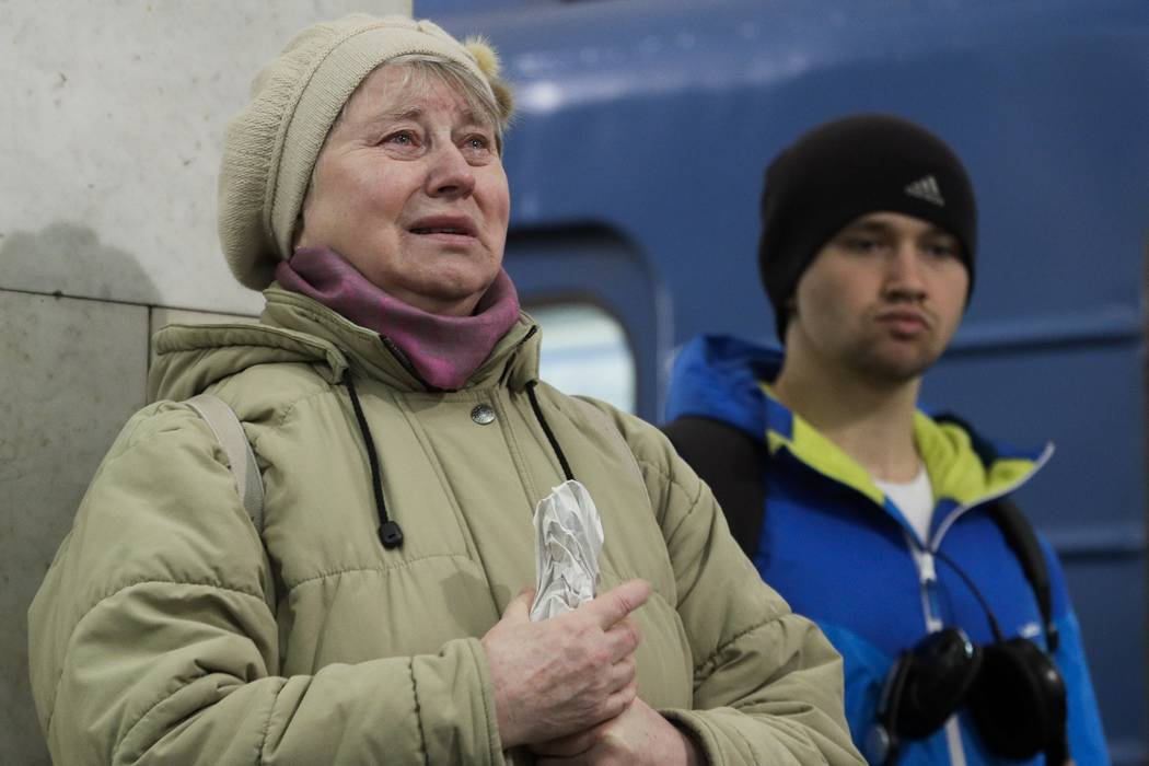 A woman cries as she pays her last respects at a symbolic memorial at Tekhnologichesky Institute subway station in St. Petersburg, Russia, Tuesday, April 4, 2017.  (Dmitri Lovetsky/AP)