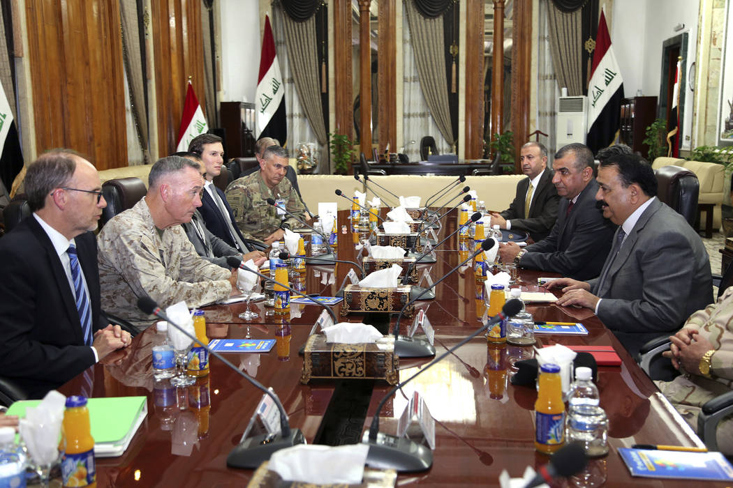 Chairman of the U.S. Joint Chiefs of Staff Gen. Joseph Dunford, second from left, meets with Iraqi Defense Minister Ifran al-Hayali, right, at the Ministry of Defense in Baghdad, Iraq, Monday, Apr ...