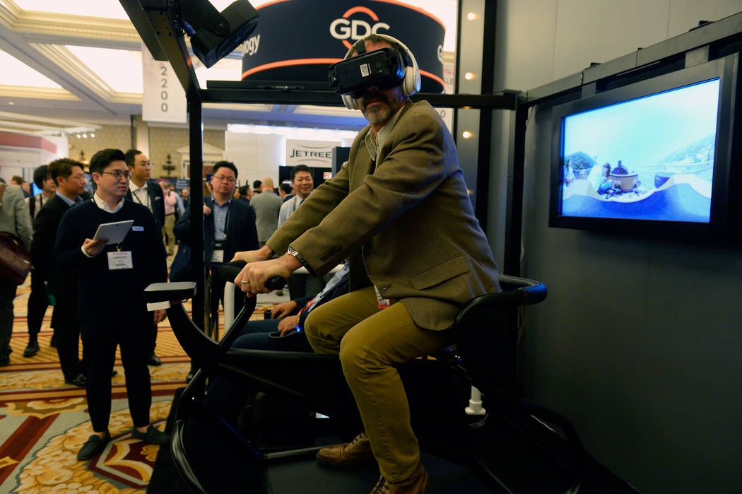 LAS VEGAS, NV - MARCH 28:  A guest experiences the 4DX VR sports attraction during CinemaCon, the official convention of the National Association of Theater Owners at Caesars Palace on March 28, 2 ...