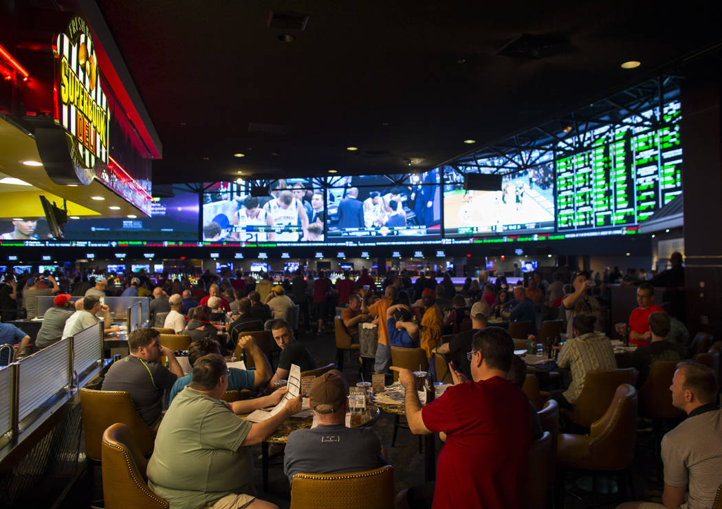 People sit outside the Superbook Deli during the first day of the NCAA basketball tournament at the Westgate sports book in Las Vegas on March 16, 2017. (Chase Stevens/Las Vegas Review-Journal) @c ...