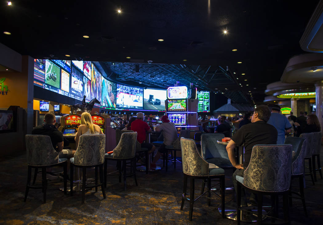 Fans take in the first day of the NCAA basketball tournament at the Westgate sports book in Las Vegas on March 16, 2017. (Chase Stevens/Las Vegas Review-Journal) @csstevensphoto