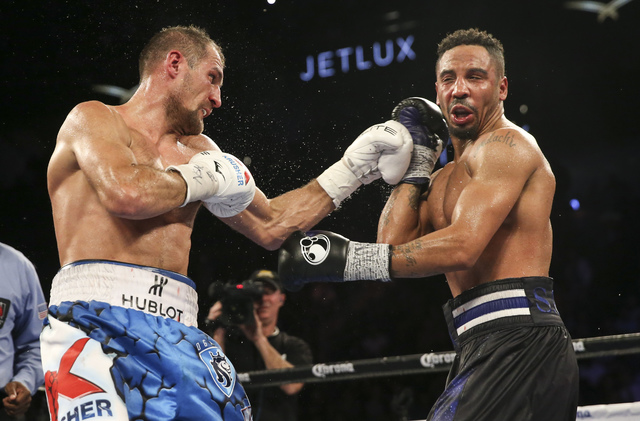 Sergey Kovalev, left, hits Andre Ward during their light heavyweight title boxing match at T-Mobile Arena in Las Vegas on Saturday, Nov. 19, 2016. Ward won in a unanimous decision. Chase Stevens/L ...