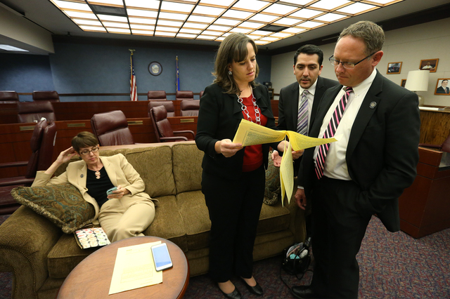 Assembly Democrats, from left, Heidi Swank, Amber Joiner, Nelson Araujo and Mike Sprinkle work in a caucus room at the Nevada Legislature in Carson City, Nev. on Tuesday, Oct. 11, 2016. Lawmakers  ...