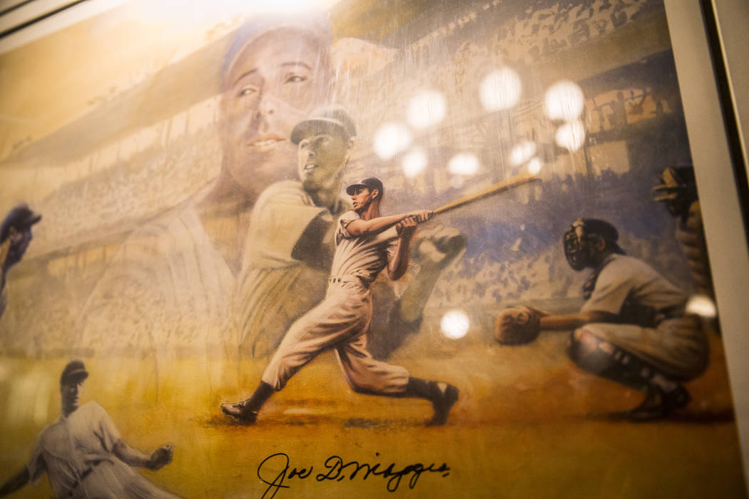 Photos, paintings and other memorabilia significant to Las Vegas, such as this illustration of New York Yankee center fielder Joe DiMaggio, decorate the walls at the Golden Steer Steakhouse on Wed ...