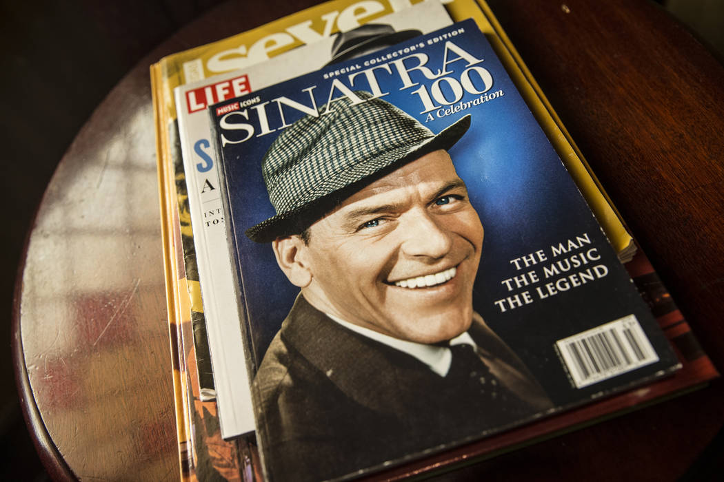 Photos, paintings and other memorabilia significant to Las Vegas, such as this Music Icons Magazine celebrating Frank Sinatra, decorate the walls at the Golden Steer Steakhouse on Wednesday, April ...