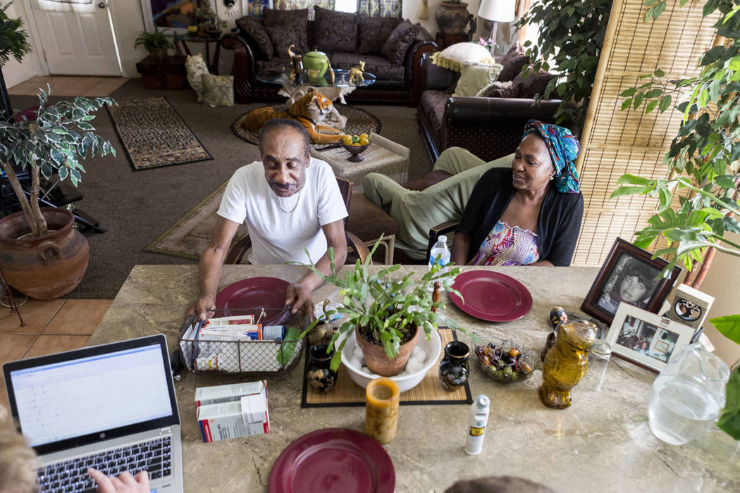 Roosevelt Bennett, left, receives care from nurse practitioners with Healthcare Partners of Nevada with his wife Brenda Bennett in their Henderson home Wednesday, April 5, 2017. (Elizabeth Brumley ...