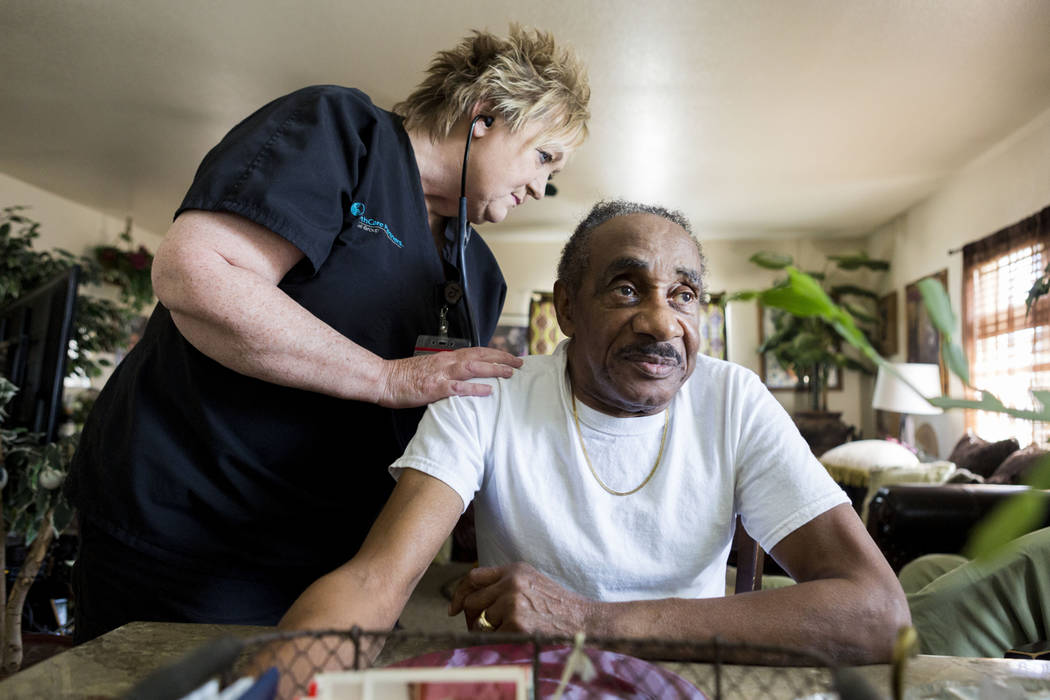 Healthcare Partners of Nevada Nurse practitioner Judith Trevisano listens to Roosevelt Bennett heartbeat in his Henderson home Wednesday, April 5, 2017. (Elizabeth Brumley Las Vegas Review-Journal ...