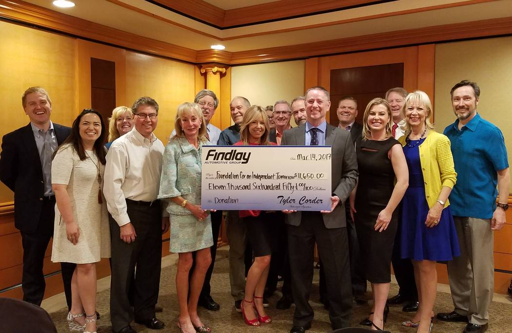 Findlay Automotive Group recently provided a check for $11,650 to the Foundation for an Independent Tomorrow. Holding the check are, from left, FIT founder and CEO Janet Blumen, FIT board member a ...