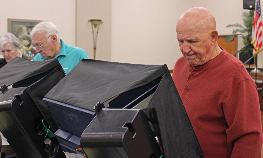 Bill Lombardo, 78, right, casts his ballot for the Henderson municipal election at Sun City MacDonald Ranch, Tuesday, April 4, 2017, as Doris and Robert Leonard from left, casting their ballots. G ...
