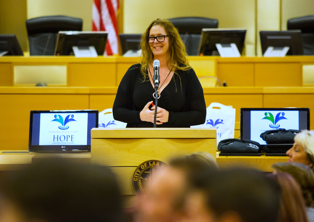 Heidi Almase, a Las Vegas Municipal Court judge, leads a graduation ceremony for people from Habitual Offender Prevention and Education (HOPE) and Youth Offender courts Thursday, Jan. 15, 2015 at  ...