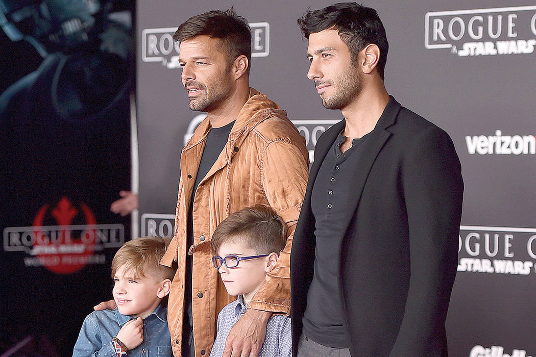 "Ricky Martin, left, his fiance Jwan Yosef and sons Matteo Martin and Valentino Martin attend the premiere of ""Rogue One: A Star Wars Story"" at Pantages Theater on Saturday, Dec. 10, 2016, in Los A ..."