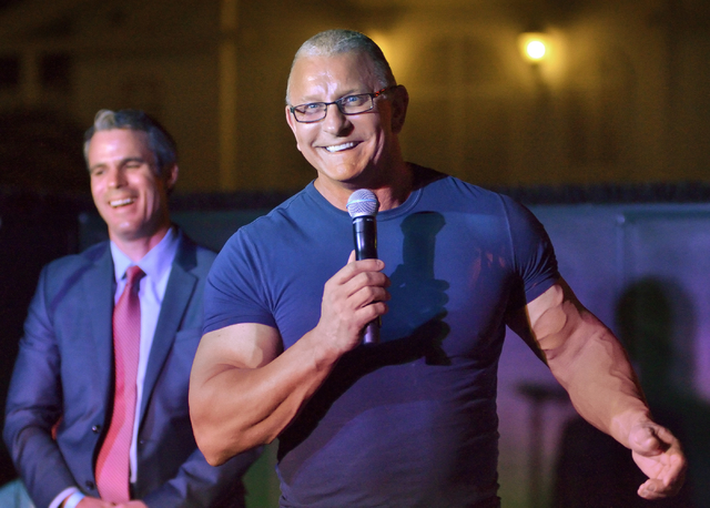 Eric Schippers, senior vice president at Penn National Gaming, listens to chef Robert Irvine during an announcement Monday, May 16, 2016, that Irvine will open a restaurant at The Tropicana in Las ...