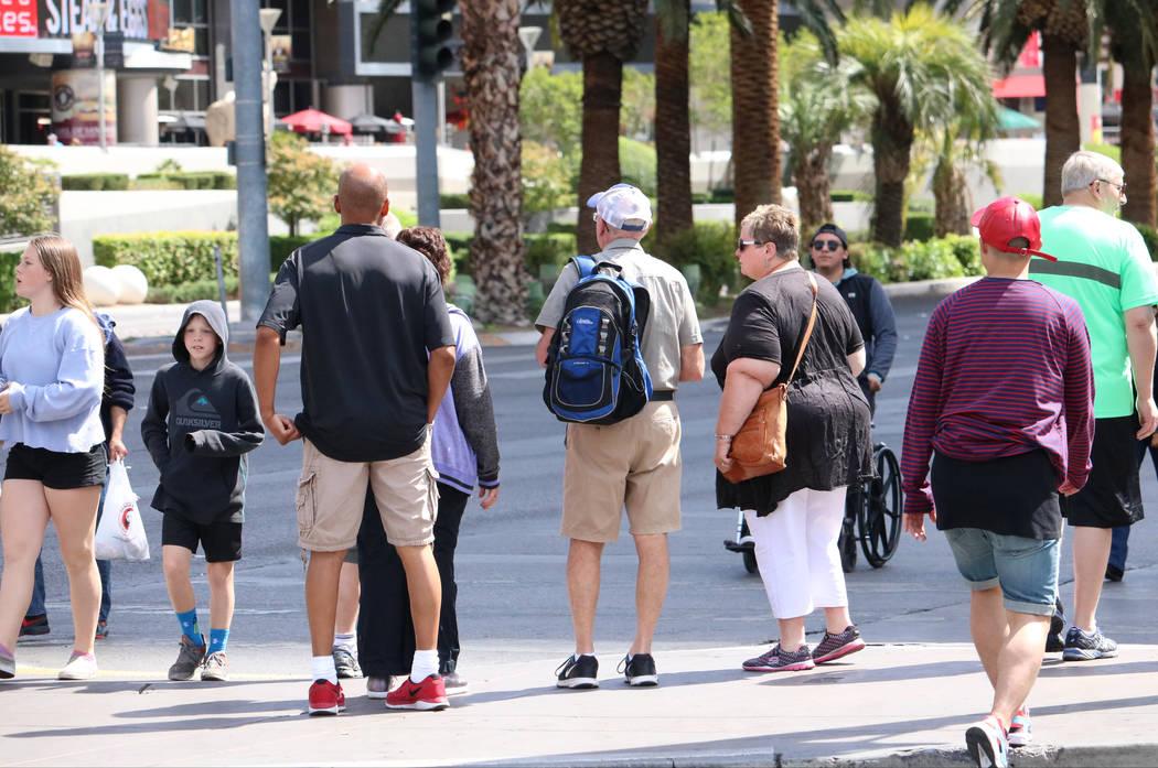 Pedestrians wait to cross the street in front of Caesars Palace hotel-casino, Wednesday, April 5, 2017 in Las Vegas. (Gabriella Benavidez Las Vegas Review-Journal) @gabbydeebee