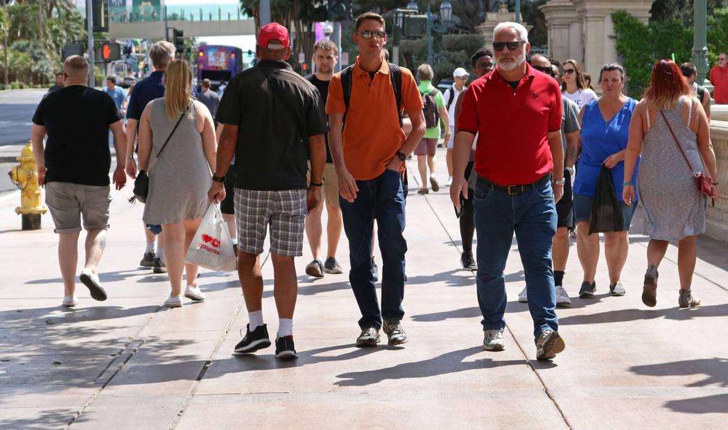 Pedestrians walk past the Bellagio hotel-casino, Wednesday, April 5, 2017 in Las Vegas. (Gabriella Benavidez Las Vegas Review-Journal) @gabbydeebee